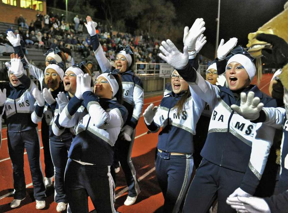 Rensselaer cheerleaders react as their team takes a lead during their Class D semifinal game against Tuckahoe at Dietz Stadium in Kingston Friday Nov. 16, 2012.  (John Carl D'Annibale / Times Union) Photo: John Carl D'Annibale / 00020085A