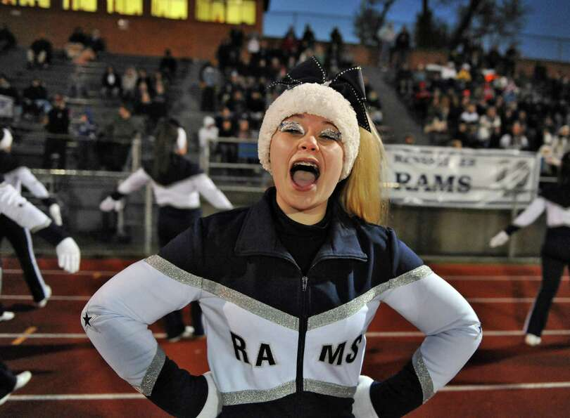 Rensselaer cheerleader Erica Murray cheers from the sidelines during their Class D semifinal game ag