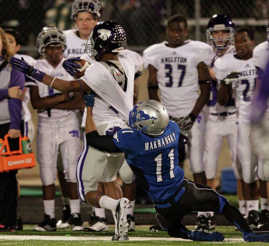Angleton's Joshawa West is dragged down by Friendswood's Anthony Makransky during a high school football game between Angleton and Friendswood in a Class 4A Division 1 playoffs at Hall Stadium on November 16, 2012. Photo: Bob Levey, Houston Chronicle / ©2012 Bob Levey