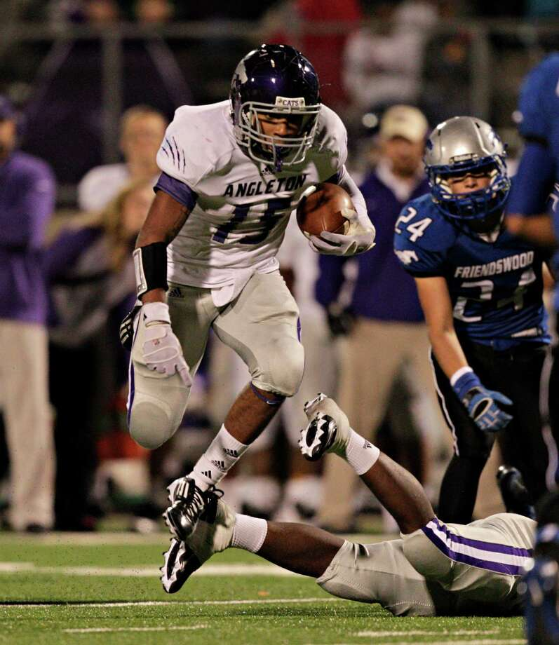 Angleton's Richard Cooper leaps over a lineman for a big gain during a high school football game between Angleton and Friendswood in a Class 4A Division 1 playoffs at Hall Stadium on November 16, 2012. Angleton won 48-41. Photo: Bob Levey, Houston Chronicle / ©2012 Bob Levey