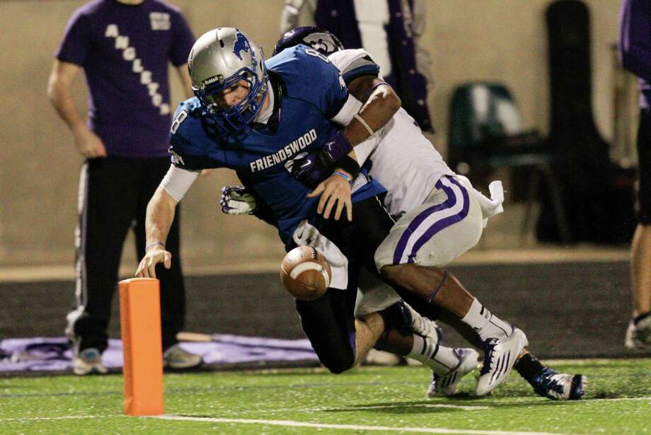 Angleton 48,Friendswood 41,Friendswood quarterback Jordan Wood fumbles the ball before crossing the goal line as Angleton's Joshawa West knocks it loose during a high school football game between Angleton and Friendswood in a Class 4A Division 1 playoffs at Hall Stadium on November 16, 2012. Angleton won 48-41. Photo: Bob Levey, Houston Chronicle / ©2012 Bob Levey
