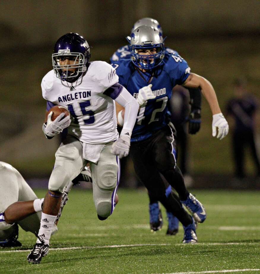 Angleton's Richard Cooper #15 looks for room to run as Friendswood's Sean White pursues during a high school football game between Angleton and Friendswood in a Class 4A Division 1 playoffs at Hall Stadium on November 16, 2012. Angleton won 48-41. Photo: Bob Levey, Houston Chronicle / ©2012 Bob Levey