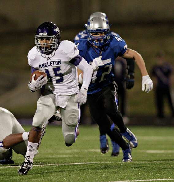 Angleton's Richard Cooper #15 looks for room to run as Friendswood's Sean White pursues during a hig