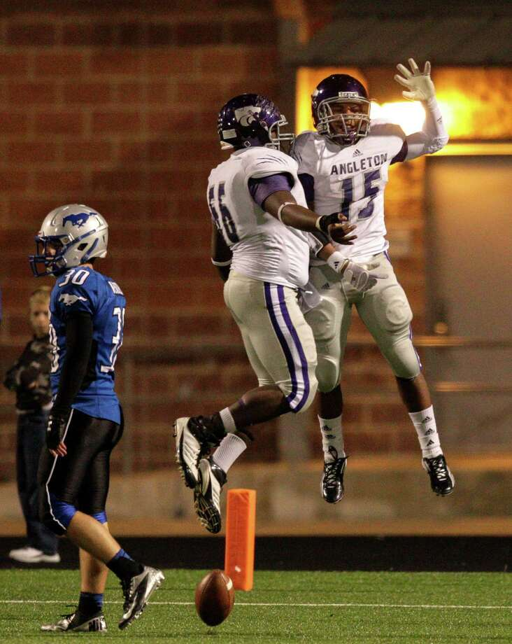 Angleton's Richard Cooper #15 and Wilson Cambell #56 celebrate after a score during a high school football game between Angleton and Friendswood in a Class 4A Division 1 playoffs at Hall Stadium on November 16, 2012. Angleton won 48-41. Photo: Bob Levey, Houston Chronicle / ©2012 Bob Levey