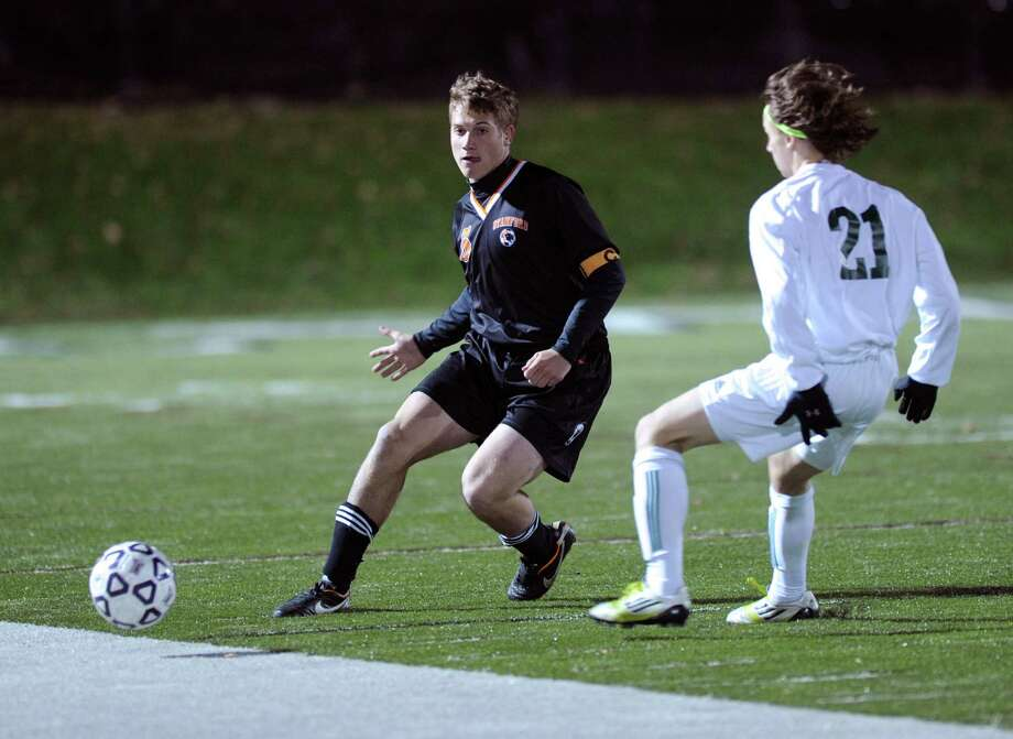 Stamford's Kyle Carey and Norwalk's Nicolas Samperez compete for control of the ball during Friday's Class LL boys soccer semifinal game at New Canaan High School on November 16, 2012. Photo: Lindsay Niegelberg / Stamford Advocate