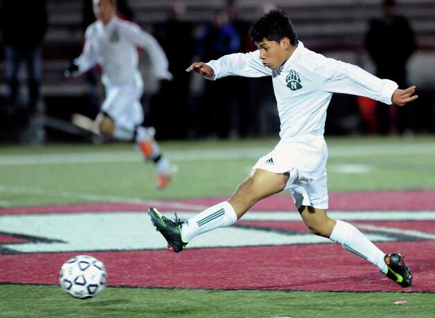 Norwalk's Jose Canahui controls the ball during Friday's Class LL boys soccer semifinal game at New Canaan High School on November 16, 2012. Photo: Lindsay Niegelberg / Stamford Advocate