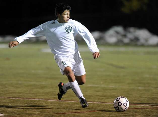Norwalk's Eric Altamura controls the ball during Friday's Class LL boys soccer semifinal game at New Canaan High School on November 16, 2012. Photo: Lindsay Niegelberg / Stamford Advocate