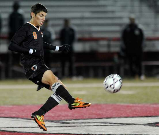 Stamford's Gustavo Torrealba controls the ball during Friday's Class LL boys soccer semifinal game at New Canaan High School on November 16, 2012. Photo: Lindsay Niegelberg / Stamford Advocate