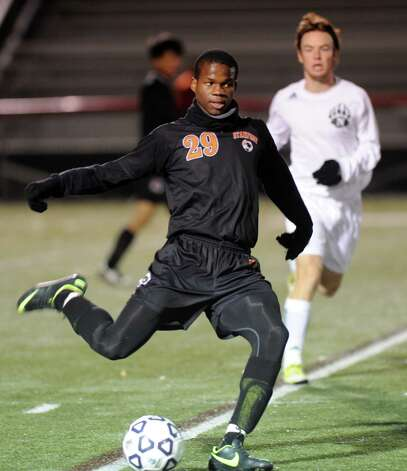 Stamford's Marc Guirand controls the ball during Friday's Class LL boys soccer semifinal game at New Canaan High School on November 16, 2012. Photo: Lindsay Niegelberg / Stamford Advocate