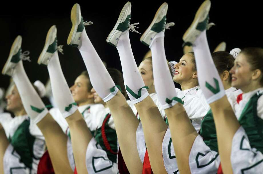 Members of The Woodlands Highsteppers perform during the halftime of Friday night's 66-42 playoff win over Klein Collins. Photo: J. Patric Schneider, Freelance / © 2012 Houston Chronicle