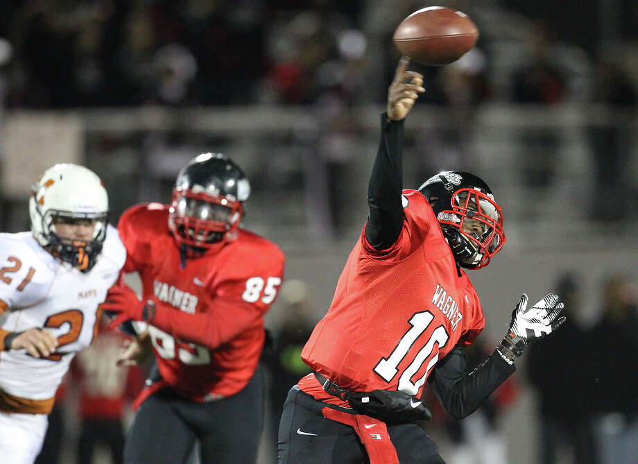 Wagner quarterback Tekoa Bryant-Mckinnies (10) makes a throw against Madison in the Class 5A District I playoff game in the second half at Rutledge Stadium on Friday, Nov. 16, 2012. Madison moves on with a 37-21 win over Wagner. Photo: Kin Man Hui, Express-News / © 2012 San Antonio Express-News