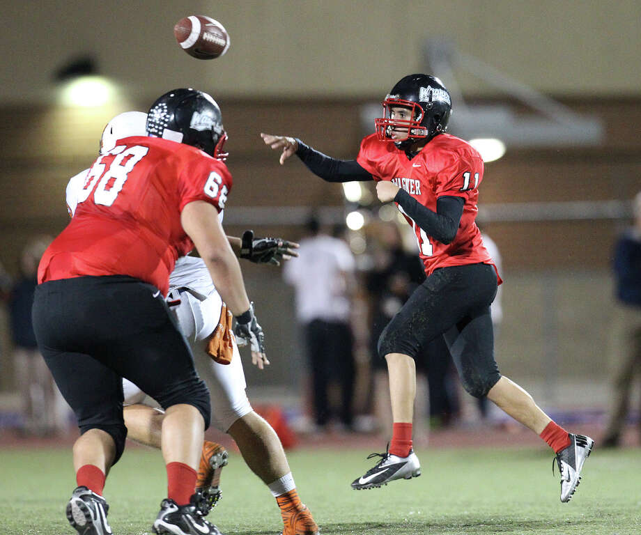 Wagner quarterback Christian Ruiz (11) makes a throw against Madison in the Class 5A District I playoff game in the first half at Rutledge Stadium on Friday, Nov. 16, 2012. Photo: Kin Man Hui, Express-News / © 2012 San Antonio Express-News