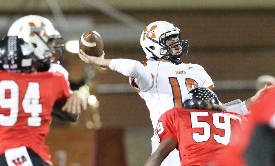 Madison quarterback Tyler Mangold (18) makes a throw under pressure from Wagner in the Class 5A District I playoff game in the first half at Rutledge Stadium on Friday, Nov. 16, 2012. Photo: Kin Man Hui, Express-News / © 2012 San Antonio Express-News