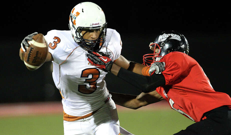 Madison's Dannon Cavil (03) fends off Wagner's Jacorey Walker (05) after a pass reception in the