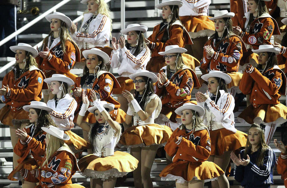 The Madison dance squad cheers on football team against Wagner in the Class 5A District I playoff game in the second half at Rutledge Stadium on Friday, Nov. 16, 2012. Madison moves on with a 37-21 win over Wagner. Photo: Kin Man Hui, Express-News / © 2012 San Antonio Express-News