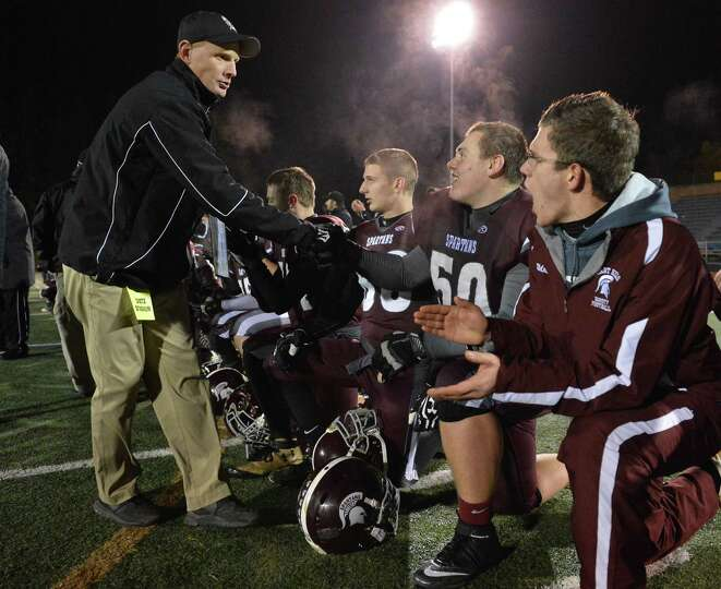Burnt Hills head coach Matt Shell, left, congratulates each member of his team after winning the Cla