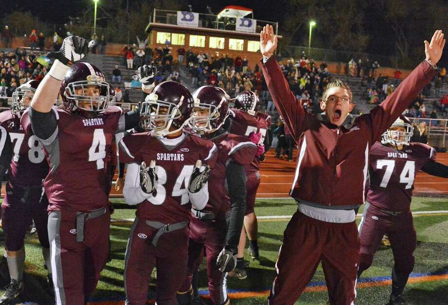 The Burnt Hills bench erupts in cheers after winning the Class A semifinal against Cornwall High at Dietz Stadium in Kingston Friday Nov. 16, 2012.  (John Carl D'Annibale / Times Union) Photo: John Carl D'Annibale / 00020084A