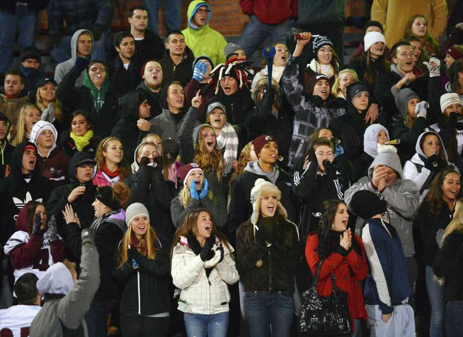 Burnt Hills fans cheer their team scores during the Class A semifinal against Cornwall High at Dietz Stadium in Kingston Friday Nov. 16, 2012.  (John Carl D'Annibale / Times Union) Photo: John Carl D'Annibale / 00020084A