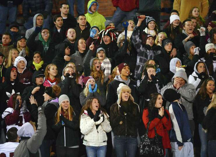 Burnt Hills fans cheer their team scores during the Class A semifinal against Cornwall High at Dietz