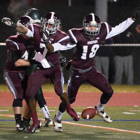 Burnt Hills' #7 Shomari Ingram and #18 William Chapman celebrate Shomari's interception during their Class A semifinal against Cornwall High at Dietz Stadium in Kingston Friday Nov. 16, 2012.  (John Carl D'Annibale / Times Union) Photo: John Carl D'Annibale / 00020084A