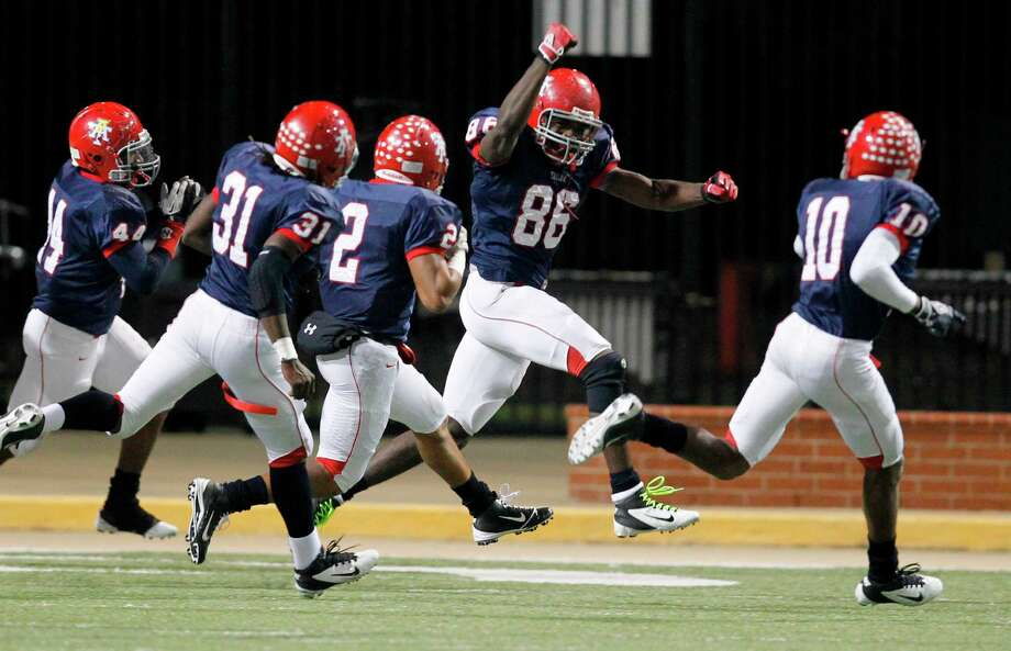 Alief Taylor's Torrodney Prevot (86) celebrates the first of his two defensive touchdowns against Cy-Fair. He followed up on his interception return for a touchdown with a fumble return for a touchdown. Photo: Mayra Beltran, Staff / © 2012 Houston Chronicle