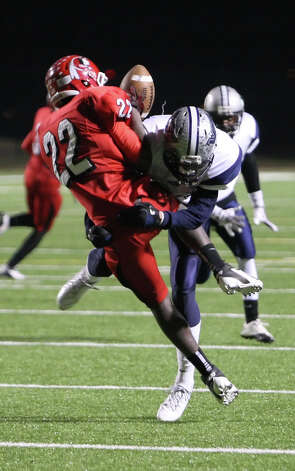 West Orange-Stark defensive back J Marcus Rhodes, right, forces an incomplete pass during the Class 3A Division II playoff game against Cleveland Friday at the Beaumont ISD Thomas Center. (Matt Billiot/Special to the Enterprise)
