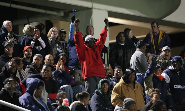 West Orange-Stark fans cheer following a touchdown during the Class 3A Division II playoff game against Cleveland Friday at the Beaumont ISD Thomas Center. (Matt Billiot/Special to the Enterprise)