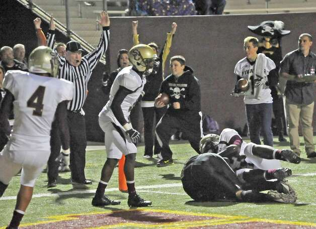 The referee puts his hands up as Pirate #12,Colby Sciarrilla, scores Vidor's second touchdown. The Vidor High School Pirates football team played the Humble Summer Creek Bulldogs at 7 p.m. Friday night at Clyde Abshier Stadium in Deer Park Texas. This is a Class 4A Division I first round game.  At the half, Humble Summer Creek was ahead 24-14. Dave Ryan/The Enterprise Photo: Dave Ryan