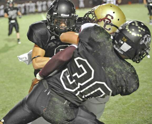 Pirates #30, Steven Niemczynski and a teammate, pull the Bulldog runner down. The Vidor High School Pirates football team played the Humble Summer Creek Bulldogs at 7 p.m. Friday night at Clyde Abshier Stadium in Deer Park Texas. This is a Class 4A Division I first round game.  At the half, Humble Summer Creek was ahead 24-14. Dave Ryan/The Enterprise Photo: Dave Ryan