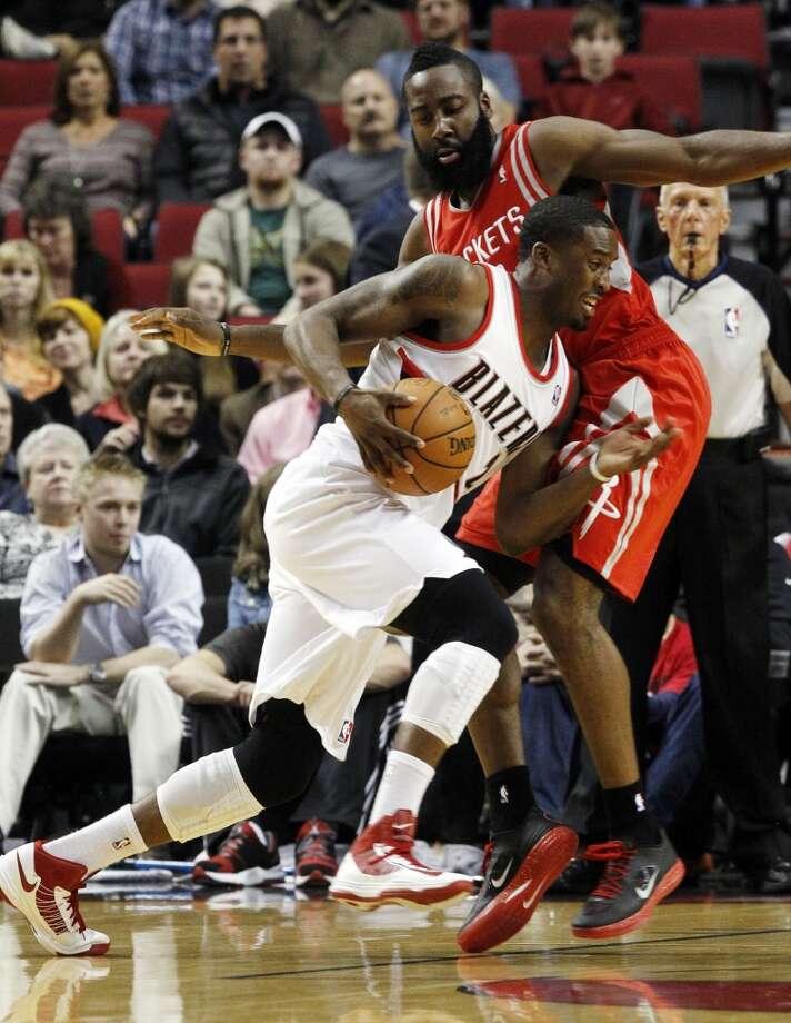 Blazers guard Wesley Matthews, left, drives on Rockets guard James Harden. (Don Ryan / Associated Press)