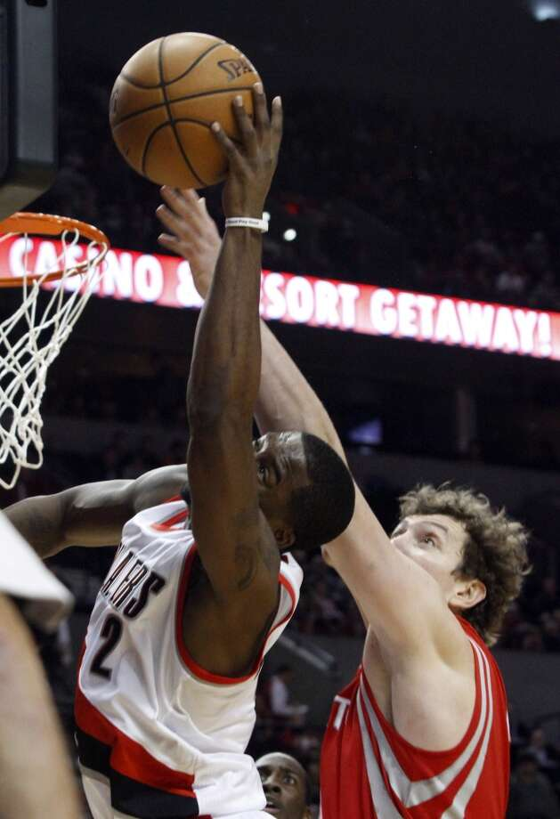 Blazers guard Wesley Matthews, left, and Rockets center Omer Asik battle for a rebound. (Don Ryan / Associated Press)