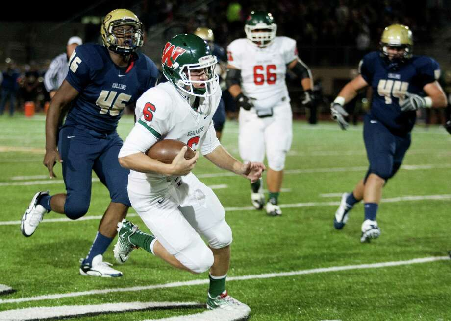 Woodlands quarterback Blaine Gillespie (6) runs for a touchdown during the first quarter of the Highlanders 66-42 playoff win over Klein Collins at Klein Memorial Stadium. Photo: J. Patric Schneider, Freelance / © 2012 Houston Chronicle
