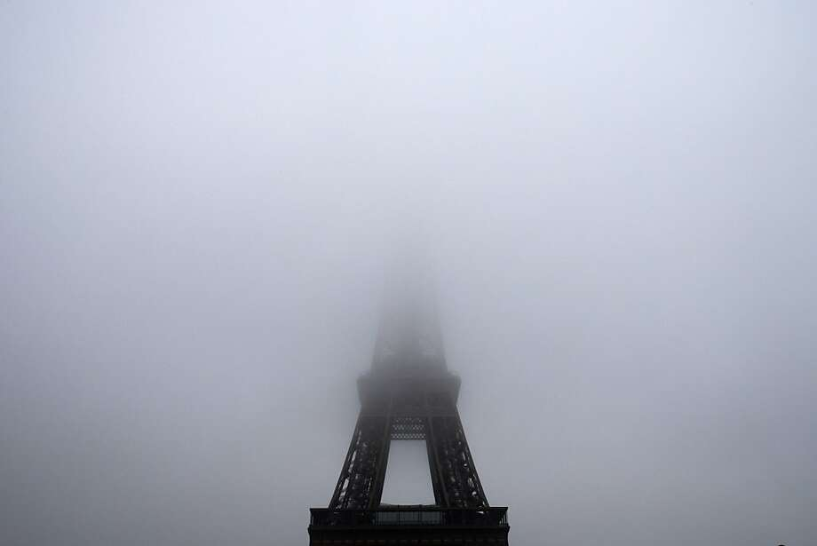 A picture taken on November 15, 2012 in Paris shows the eiffel tower partly hidden in the fog. Photo: Joel Saget, AFP/Getty Images