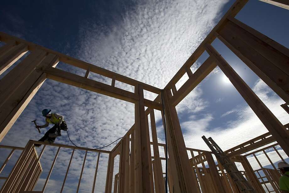 Construction worker Elabert Salazar works on a house frame for a new home Friday, Nov. 16, 2012, in Chula Vista, Calif. Employers added 45,800 new jobs in California in October, according to the state Employment Development Department. Photo: Gregory Bull, Associated Press