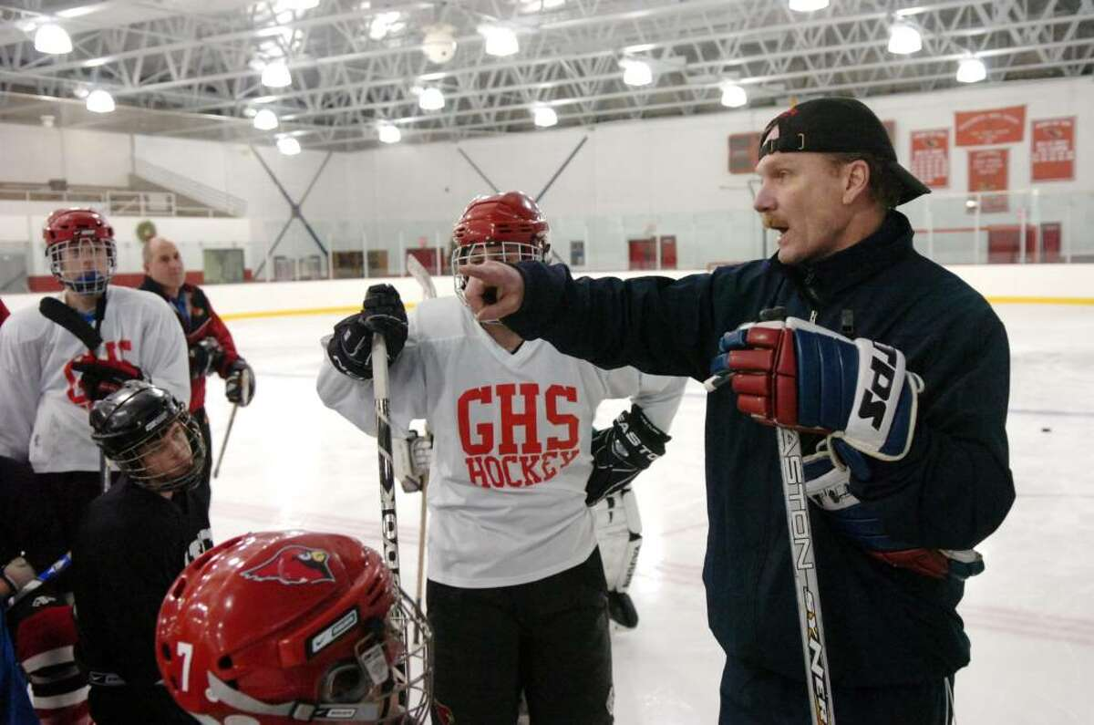 Greenwich High hockey Coach Bob Russel directs on the ice at Dorothy Hamill in Byram, CT, Tuesday evening, Dec. 15, 2009.