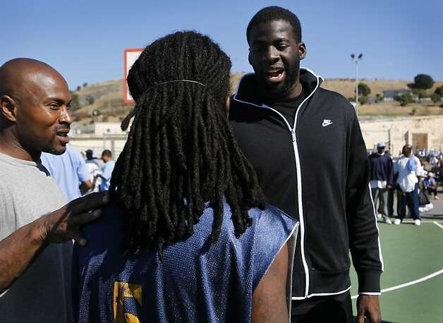 Golden State Warriors rookie Draymond Green (right) meets with inmates Lamarr Mainor (left) and Ishmel Auxila-Pierrelouis after a basketball game against the San Quentin Warriors at San Quentin State Prison on Saturday, Sept. 22, 2012. Green was networking with inmates while other employees of the organization played in the game. Photo: Paul Chinn, The Chronicle