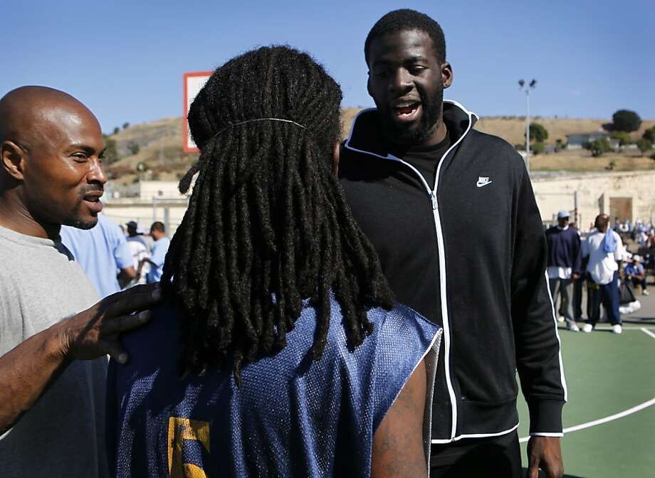 In this file photo, Golden State Warriors star power forward Draymond Green (right), then a rookie, meets with inmates Lamarr Mainor (left) and Ishmel Auxila-Pierrelouis after a basketball game against the San Quentin Warriors at San Quentin State Prison. Photo: Paul Chinn, The Chronicle