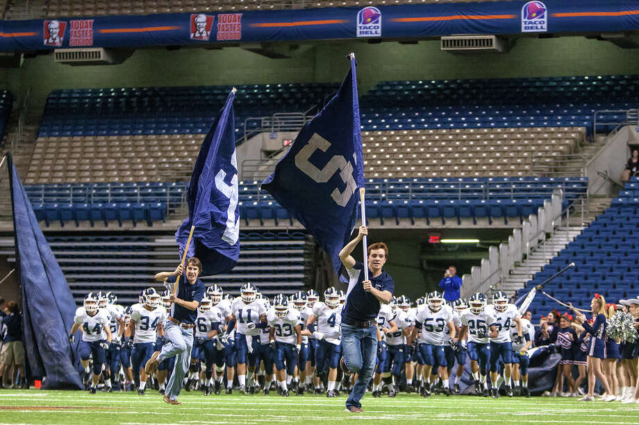 The Smithson Valley Rangers take the field prior to their Class 5A Division II first round game with Reagan at the Alamodome on Nov 16, 2012.  Smithson Valley won the game 21-14.  MARVIN PFEIFFER/ mpfeiffer@express-news.net Photo: MARVIN PFEIFFER, Express-News / Express-News 2012