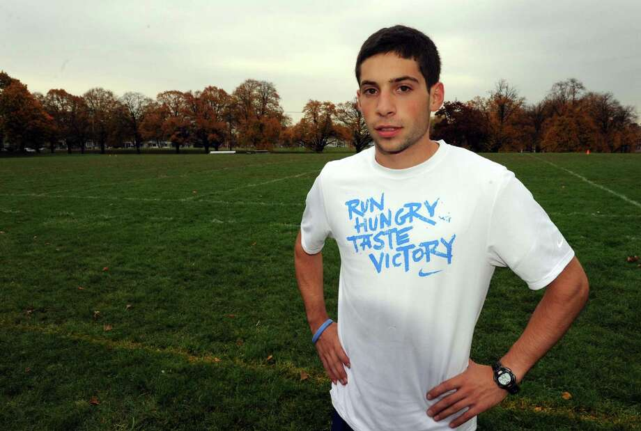 Albany High School cross country runner Philo Germano during practice in Albany, NY Tuesday Oct. 23, 2012. (Michael P. Farrell/Times Union) Photo: Michael P. Farrell / 10019781A