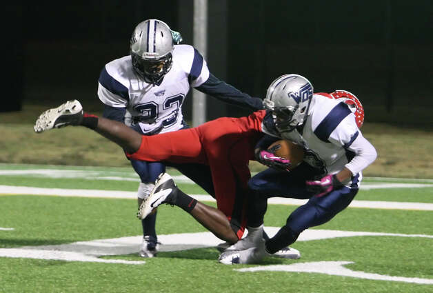 West Orange-Stark s Will Moore, No. 3, picks up the ball in the end zone for a touchdown following a blocked punt during the Class 3A Division II playoff game against Cleveland Friday at the Beaumont ISD Thomas Center. (Matt Billiot/Special to the Enterprise)