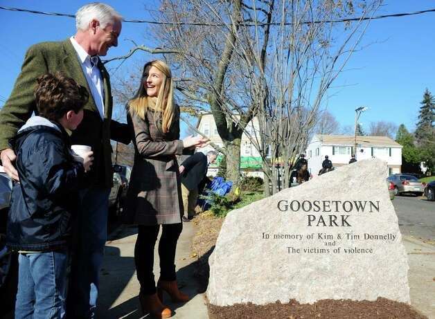 Mayor Bill Finch talks with Tara Donnelly, daughter of Tim and Kim Donnelly, during a ceremony to dedicate Goosetown Park in memory of her parents and all victims of violence Saturday, Nov. 17, 2012 at the park in Bridgeport, Conn.  Tim and Kim Donnelly were murdered during the robbery of their Fairfield jewelry store in February of 2005.  Tim Donnelly grew up around the corner from the park and raised his family in the same neighborhood. Photo: Autumn Driscoll / Connecticut Post
