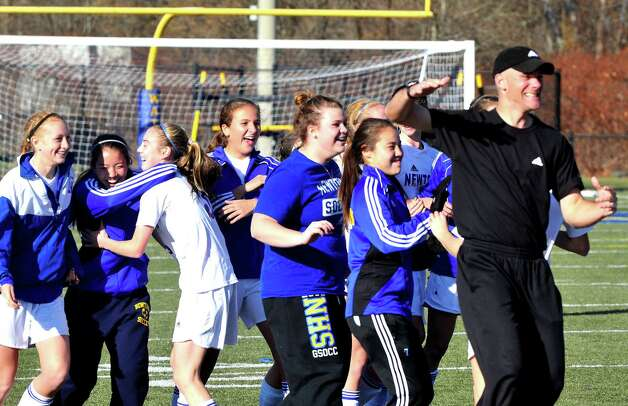 Newtown High School girls soccer celebrates beating New Milford in the Class LL state semifinals at Waterbury Saturday, Nov. 17, 2012. Photo: Michael Duffy