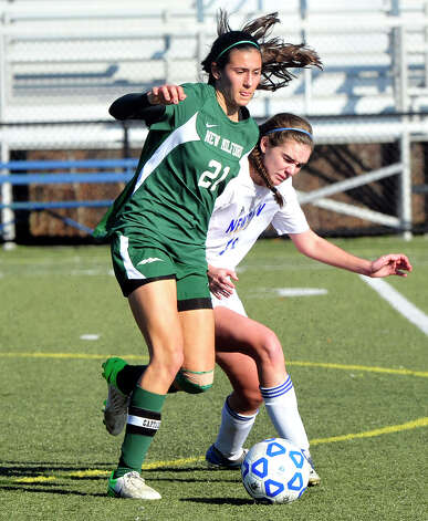 New Milford High School's Sabrina Baxter, left, and Newtown's Brenna Kelly compete in the Class LL state semifinals at Waterbury Saturday, Nov. 17, 2012. Photo: Michael Duffy