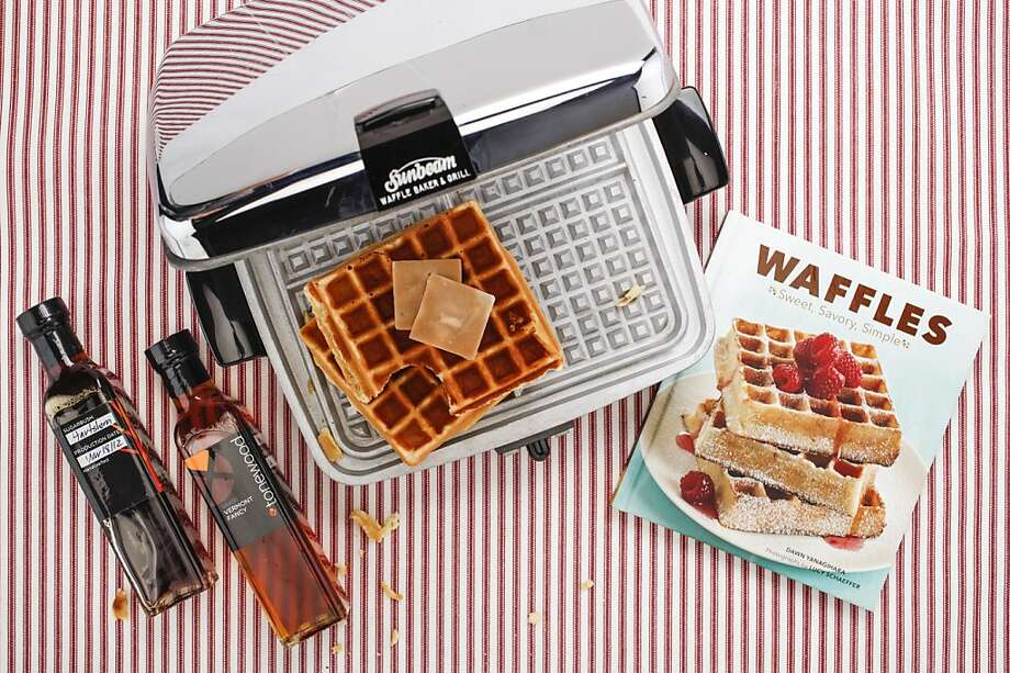 "Take a step back from the toaster.Now check your reflection in  the chrome wonder that is the Sunbeam CG Waffle Iron ($195 to $295, www.toastercentral.com). Introduced in the mid-1950s and fully restored to cook on cue without a non-stick surface by the folks who supply period electrics to the Silver Screen and the Big White way, it makes a 9-inch square confection in minutes no matter which recipe you use from ""Waffles,"" Dawn Yanagihara's guide to gridded goodness. (Chronicle Books, $16.95, www.chroniclebooks.com). Be sure to bin that bottle of high fructose corn syrup, caramel color and artificial flavors for some  sustainable, single-sourced, unblended and additive-free syrup from Tonewood Maple in Vermont's Mad River Valley. ($59.99 for a flight of four grades, 8.4 oz each, and maple sugar wafers, $16.99, www.tonewoodmaple.com). Maple sugar trees are available for adoption ($120) a process that comes entitles the parent? owner? botanical companion?to a photo, treats and recipes including one that involves Brussels sprouts. Photo: Russell Yip, The Chronicle"