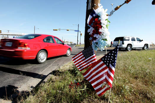 American flags, flowers, and a Texas flag left at the at the intersection, Saturday Nov. 17, 2012, in Midland, Tx., where a Union Pacific train struck a float carrying military veterans onThursday Nov. 15, 2012, killing four men, including one from the San Antonio area. Photo: Edward A. Ornelas, San Antonio Express-News / © 2012 San Antonio Express-News