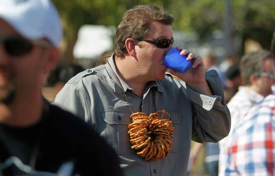 Todd Gregory of Cypress made his own pretzel necklace to wear to the beer festival. Photo: Mayra Beltran, Houston Chronicle / © 2012 Houston Chronicle