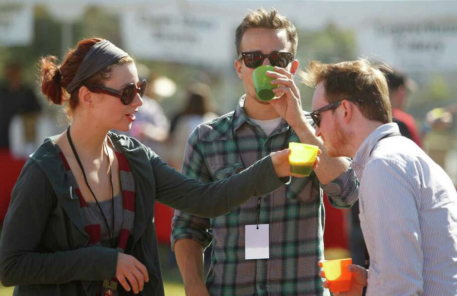 Alisha Grisham, Will Pierce, and Marshall Walker, sample each other's beers Photo: Mayra Beltran, Houston Chronicle / © 2012 Houston Chronicle