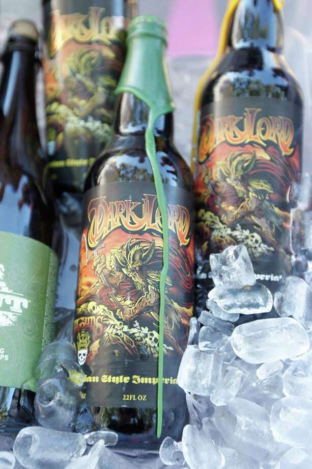 Bottles of 3 Floyds Dark Lord are selling for more than $250.00 at a silent auction. Photo: Mayra Beltran, Houston Chronicle / © 2012 Houston Chronicle