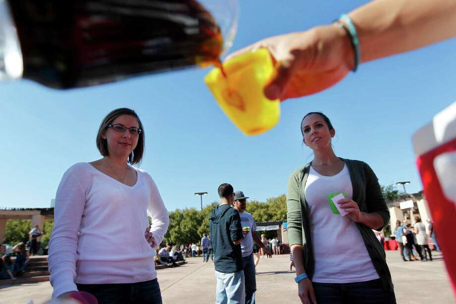 Kim Fletcher and Erin Parchman are poured Karbach samples. Photo: Mayra Beltran, Houston Chronicle / © 2012 Houston Chronicle