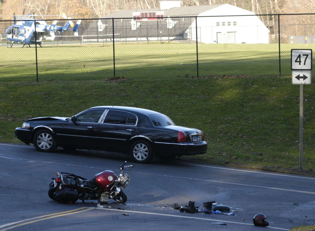 Life Star stands by Saturday afternoon on a nearby Gunnery School athletic field in Washington to transfer an injured motorcyclist to a hospital following a collision with the car seen here at the intersection of routes 47 and 199. Nov. 17, 2012